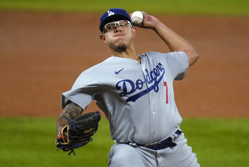 Dodgers starting pitcher Julio Urias delivers during the third inning of a 9-3 win over the Colorado Rockies.