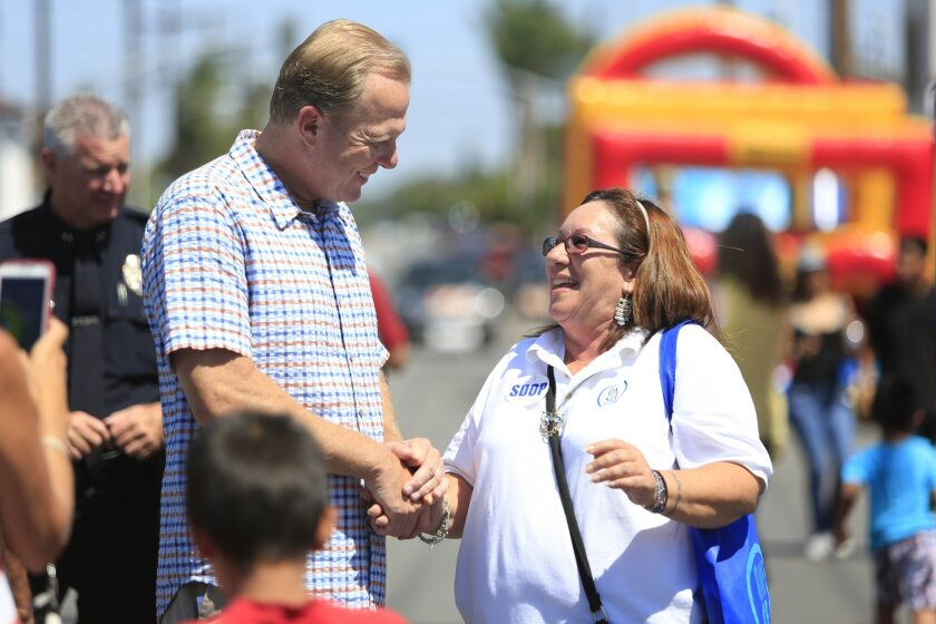 Soft politicking: San Diego Mayor Kevin Faulconer speaks with One San Diego volunteer Raquel Pagan Diaz during the Better a Block event hosted by One San Diego in August. Photo by David Brooks/ San Diego Union-Tribune.