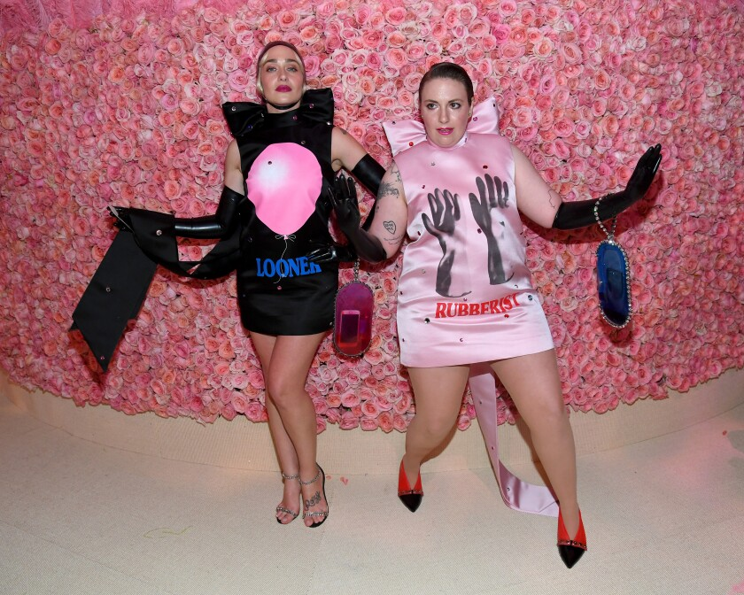 Jemima Kirke wears a black fetish-inspired dress and Lena Dunham wears a pink one