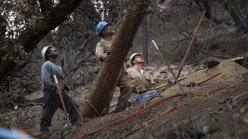 PG&E crews replace power poles in the burned out area of Mokelumne Hill following the Butte fire in Calaveras County, Calif. on Sept. 15, 2015.