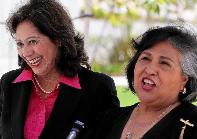 Supervisorial candidate Hilda Solis, left, received an endorsement from Supervisor Gloria Molina.