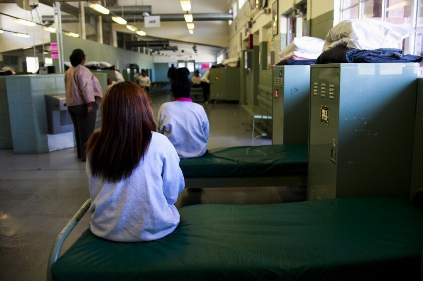 Girls detained at Camp Kenyon Scudder sit in their shared dorm space at the Santa Clarita facility.