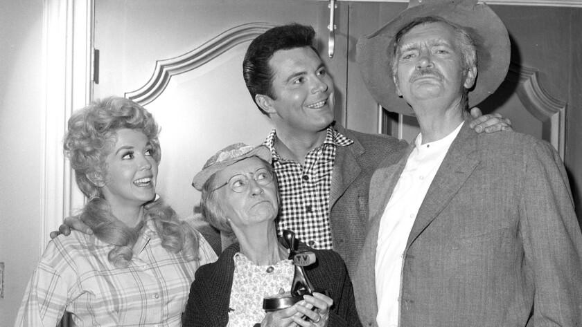 "Donna Douglas, Irene Ryan, Max Baer, Jr., and Buddy Ebsen in ""The Beverly Hillbillies."""
