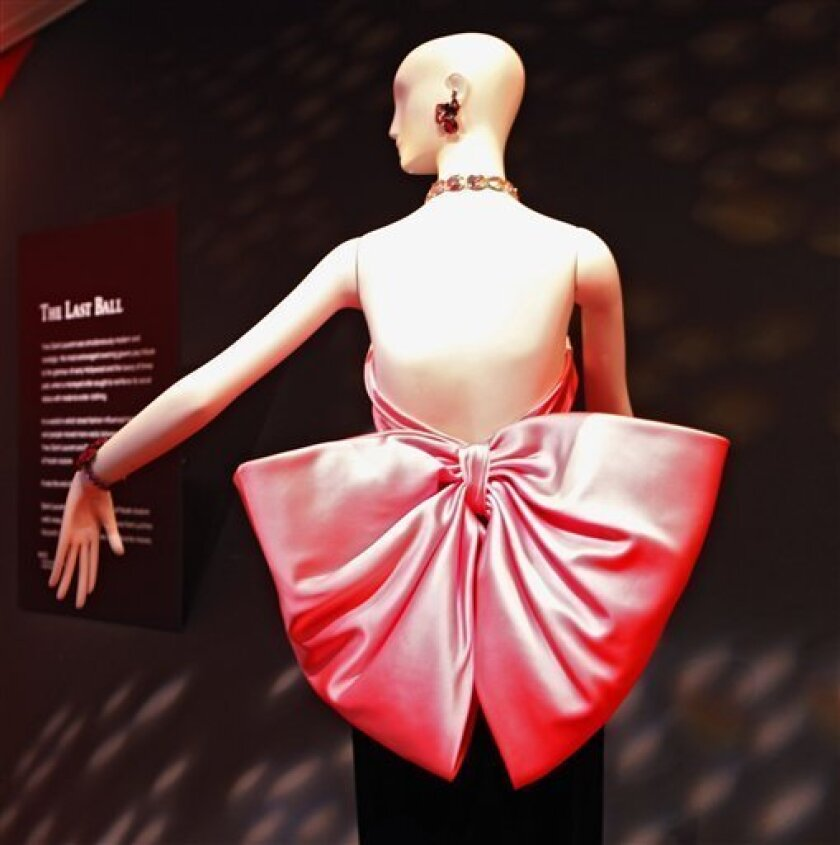 b70412c2758 Yves Saint Laurent retrospective comes to Denver. The haute-couture black  velvet ball gown with a giant pink bow from the 1983