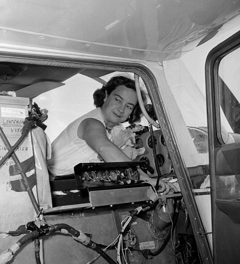 "FILE - In this April 16, 1964, file photo, Geraldine ""Jerrie"" Mock checks her extra gas tank cap before taking off from Oakland Airport, in Oakland, Calif., during a solo flight around the world. Mock, who 50 years ago became the first female pilot to fly solo around the globe, died Tuesday, Sept. 30, 2014, at her home in Florida. She was 88. (AP Photo/Robert W. Klein, File)"