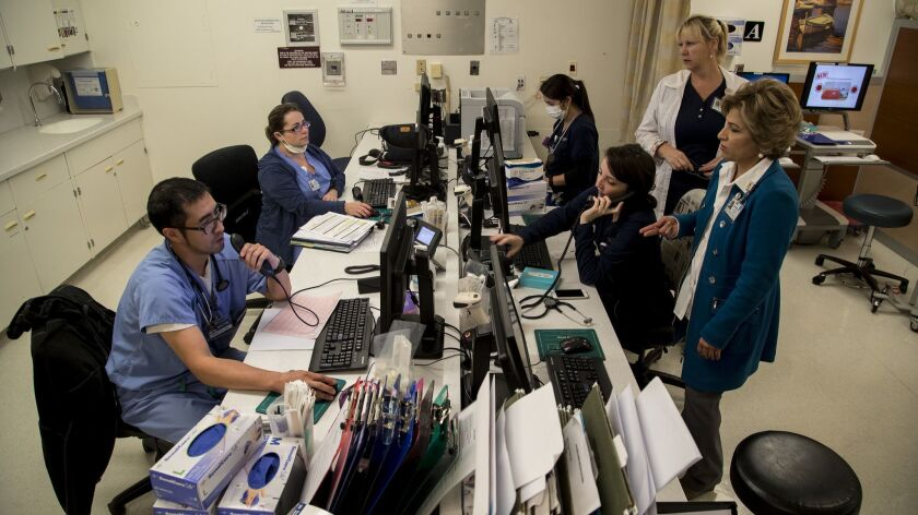 TORRANCE, CA - JANUARY 11, 2018: Nurses and doctors work at a station set up to triage flu patients