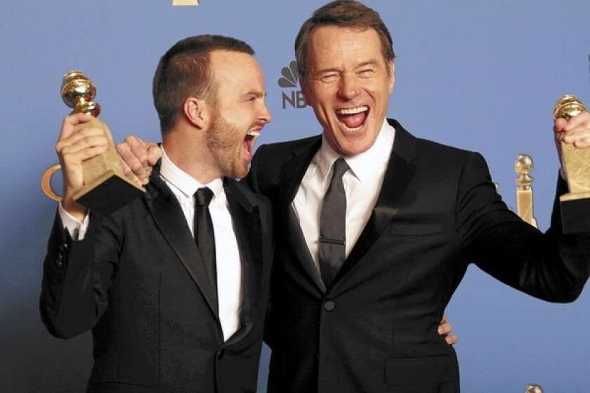 "Aaron Paul, left, and Bryan Cranston celebrate the Golden Globe win for ""Breaking Bad"" and Cranston's win for best actor in a TV drama series."
