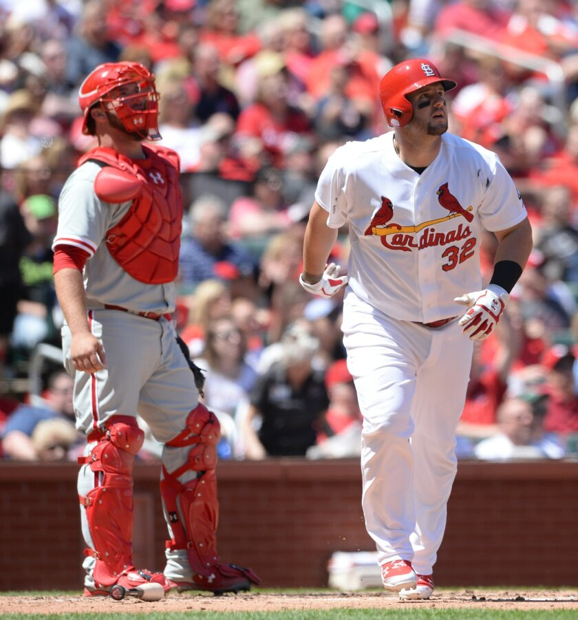 St. Louis Cardinals' Matt Adams (32) watches his two-run homerun as Philidelphia Phillies catcher  Cameron Rupp, left, looks on in the third inning in a baseball game, Thursday, April 30, 2015, at Busch Stadium in St. Louis. (AP Photo/Bill Boyce)