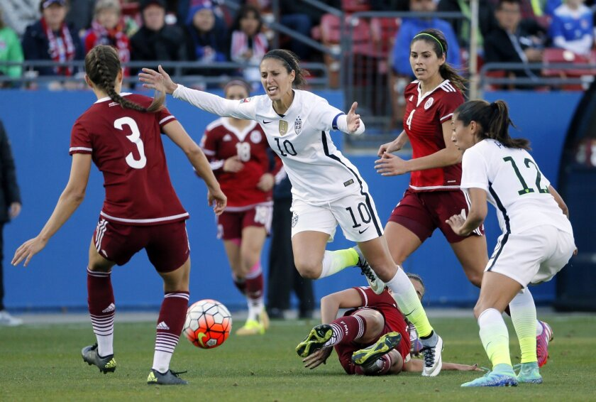 United States midfielder Carli Lloyd (10) has the ball stripped away by Nayell Rangel, bottom, as Ganelly Farias (3), Alina Garciamendez (4) and the United States' Christen Press (12) watch in the second half of a CONCACAF Olympic qualifying tournament soccer match, Saturday, Feb. 13, 2016, in Fris