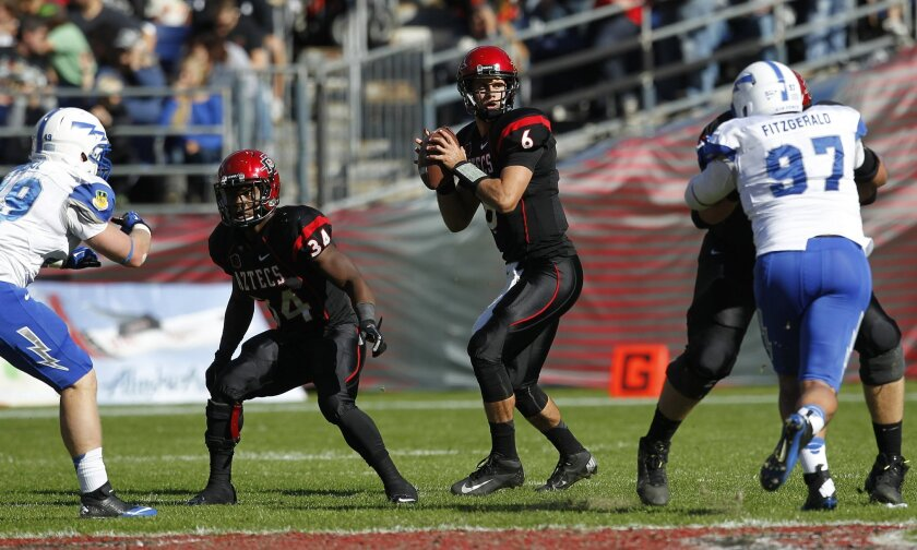 Aztec's quarterback Adam Dingwell drops back to pass during SDSU's football game against Air Force Saturday afternoon at Qualcomm Stadium.
