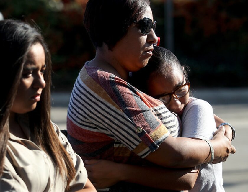 Diane Garcia comforts hear daughter Ciana, 11, during the unveiling of a memorial plaque in honor of victims of the Metrolink crash in Chatsworth five years ago. Garcia's nephew, Manuel Macias, 32, was of 24 people who died in the accident.