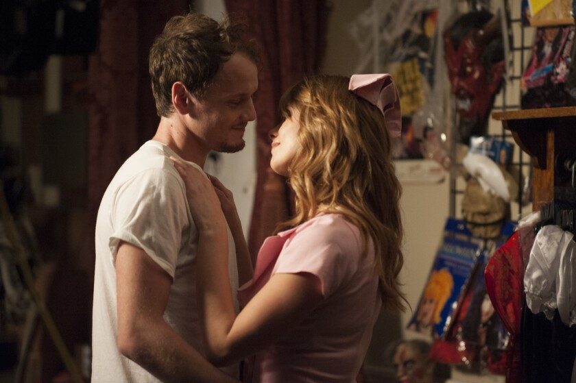 "Anton Yelchin and Ashley Greene in ""Burying the Ex."""