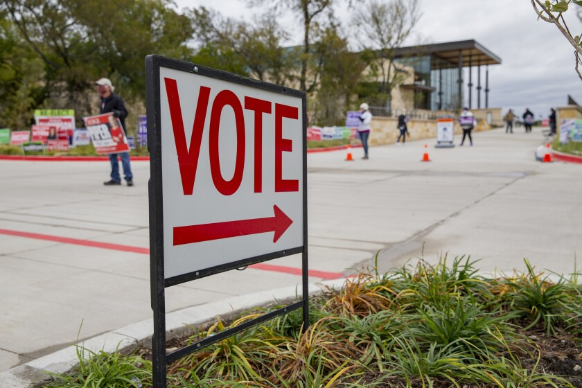 A sign directs people to an early voting location at Collin College in Wylie, Texas, on Thursday.
