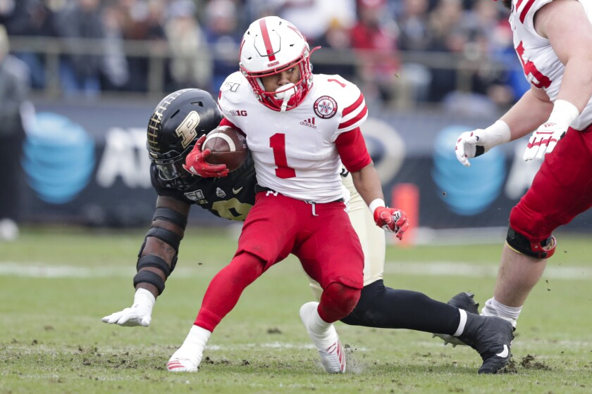 FILE - Nebraska wide receiver Wan'Dale Robinson (1) is chased down by Purdue defensive tackle Anthony Watts (8) during the first half of an NCAA college football game in West Lafayette, Ind., in this Saturday, Nov. 2, 2019, file photo. The NCAA made it official Thursday, April 15, 2021, announcing the Division I Council had voted to approve a proposal that would permit all college athletes to transfer one time as an undergraduate without having to sit out a season. Among the notable transferring football players who will now be eligible next season at their new schools are Wan'Dale Robinson, who switched from Nebraska to Kentucky. (AP Photo/Michael Conroy, File)