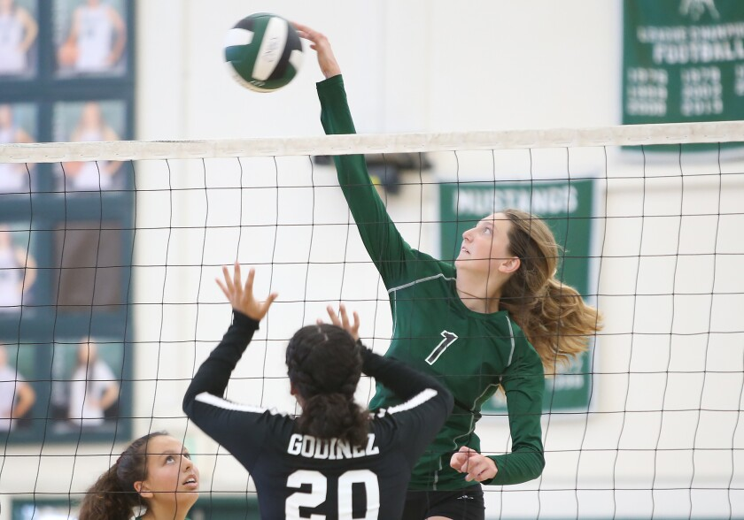 Costa Mesa's Lorelei Hobbis (1), shown making a kill against Godinez in 2019, had 21 kills in the Mustangs' victory.