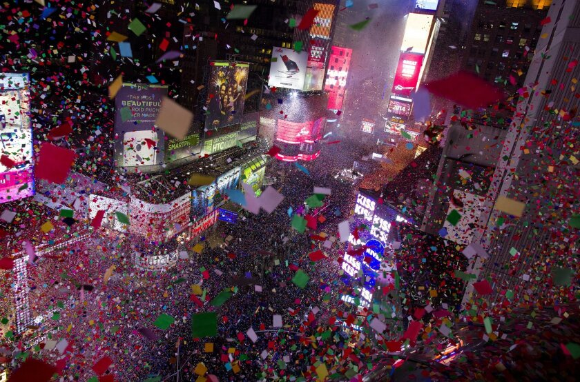 Confetti flies over Tines Square in New York Wednesday, Jan. 1, 2014 as the new year is celebrated. (AP Photo/Craig Ruttle)