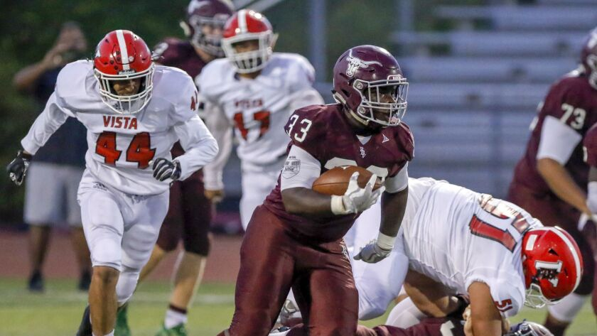 Rancho Buena Vista running back Dorian Richardson heads up field against Vista. -- Photo by Don Boom