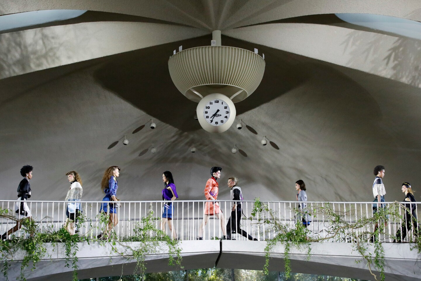 Models present looks by French designer Nicolas Ghesquière for Louis Vuitton during the brand's 2020 cruise show at the TWA Flight Center at John F. Kennedy International Airport in New York.
