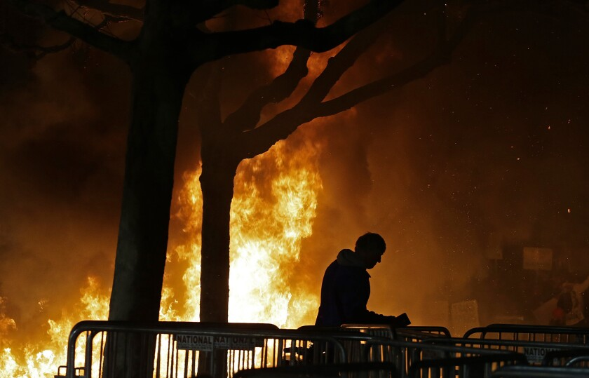 A bonfire set by demonstrators protesting a scheduled appearance by Breitbart News editor Milo Yiannopoulos at UC Berkeley.