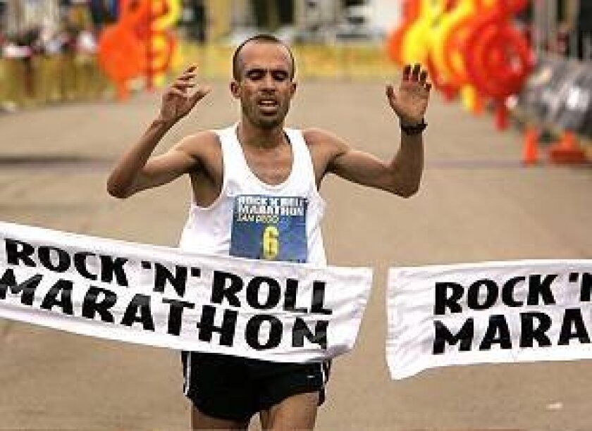 Morocco's Khalid El Boumlili is first across the finish line at Marine Corps Recruit Depot Sunday, winning the 12th Rock N'n Roll Marathon in 2:11.16.