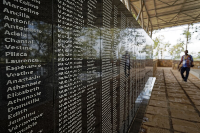 """FILE - In this Friday, April 5, 2019 file photo, the names of those who were slaughtered as they sought refuge in the church, many with the same surname indicating a family, are written on a memorial to the thousands who were killed in and around the Catholic church during the 1994 genocide, outside the church in Ntarama, Rwanda. France's role before and during 1994's Rwandan genocide was a """"monumental failure"""" that the country must face, the lead author of a sweeping report commissioned by President Emmanuel Macron said, as the country is about to open its archives from this period for the first time to the broader public. (AP Photo/Ben Curtis, File)"""