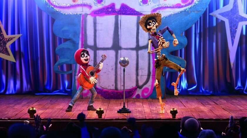 """In Disney-Pixar's """"Coco,"""" Miguel (voice of Anthony Gonzalez) teams up with a charming trickster named Hector (voice of Gael Garc'a Bernal) to unravel a generations-old family mystery."""