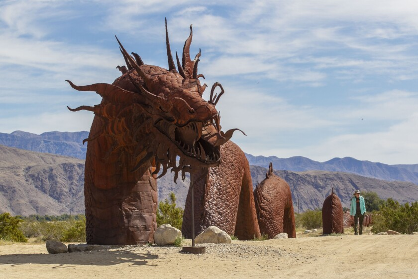 Larry Capobianco walked past one of the Carlos Breceda sculptures in Borrego Springs on April 1, 2020.