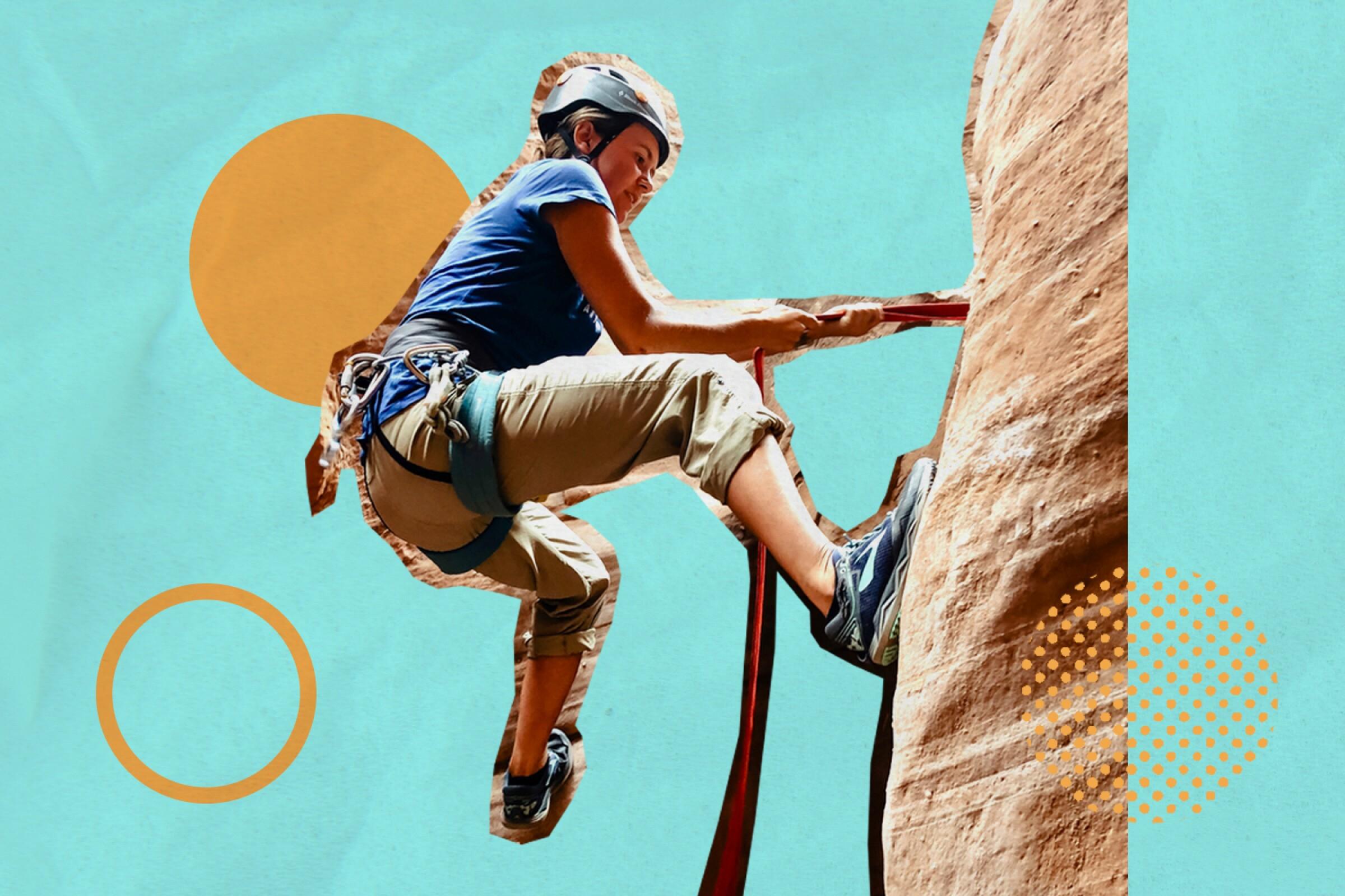 A woman climbs a canyon wall