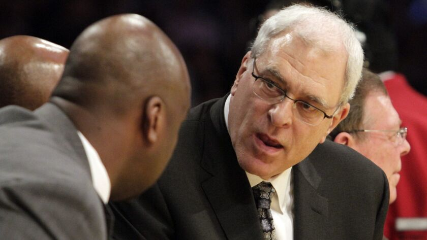 Phil Jackson responds to Chuck Person (left) in 2011 when Jackson was the head coach for the Lakers.