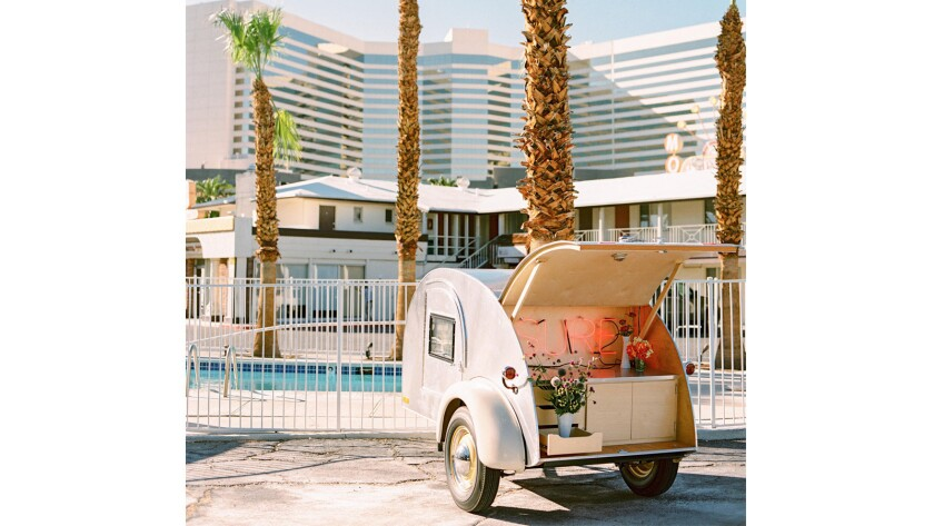The Flora Pop wedding trailer awaits a ceremony outside a motel along Las Vegas Boulevard.