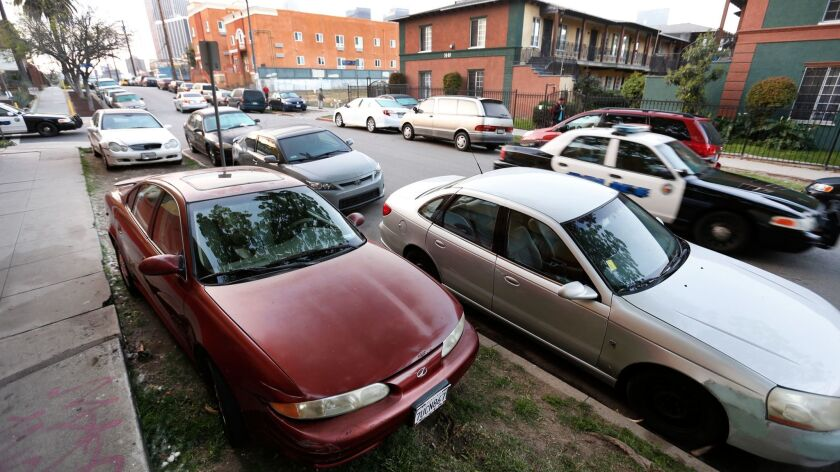 Residents park their cars on parkways — the strip of land between the sidewalk and the curb — in Westlake on March 27.