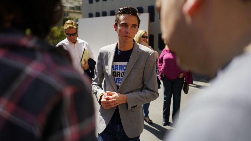 LOS ANGELES, CALIF. - APRIL 07: Parkland survivor David Hogg speaks with well wishers at The Standar