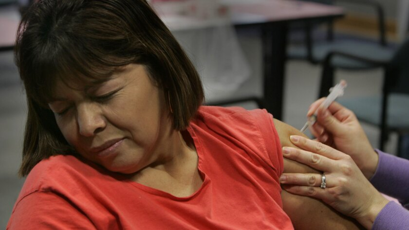 The measles outbreak has brought a renewed focus on getting adults vaccinated. Maria Rodriguez receives a shot at the Villa Parke Community Center in Pasadena in 2006.