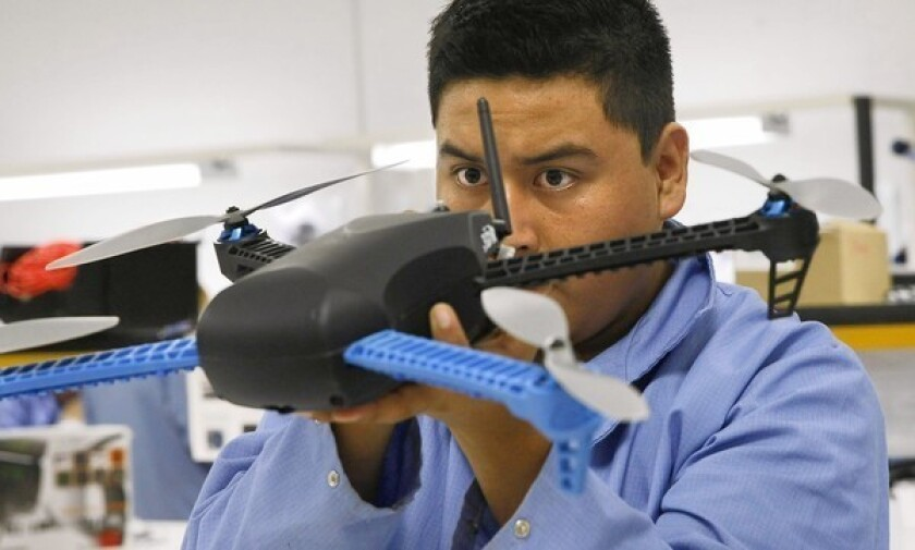 Oceas Verona Orocio inspects the latest-model drone at the 3D Robotics manufacturing plant in Tijuana. The company's drones were formerly made in China.