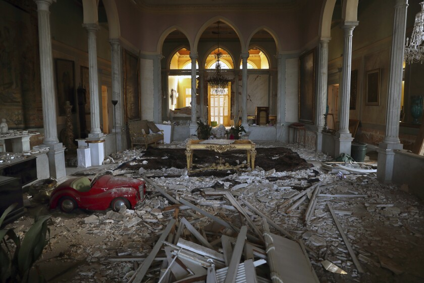 Debris from the ceiling and walls cover the floor of a room in the 150-year-old Sursock Palace that was damaged by the Aug. 4 explosion that hit the seaport of Beirut, Lebanon, Monday, Sept. 14, 2020. Restoring Beirut's architectural heritage from the August blast will take hundreds of millions of dollars and costs will quickly rise if no action is taken ahead of the onset of the rainy season in less than two months time, international experts announced Tuesday. (AP Photo/Bilal Hussein)