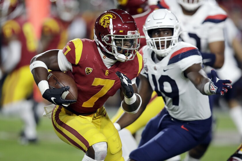 USC running back Stephen Carr carries the ball against Arizona.
