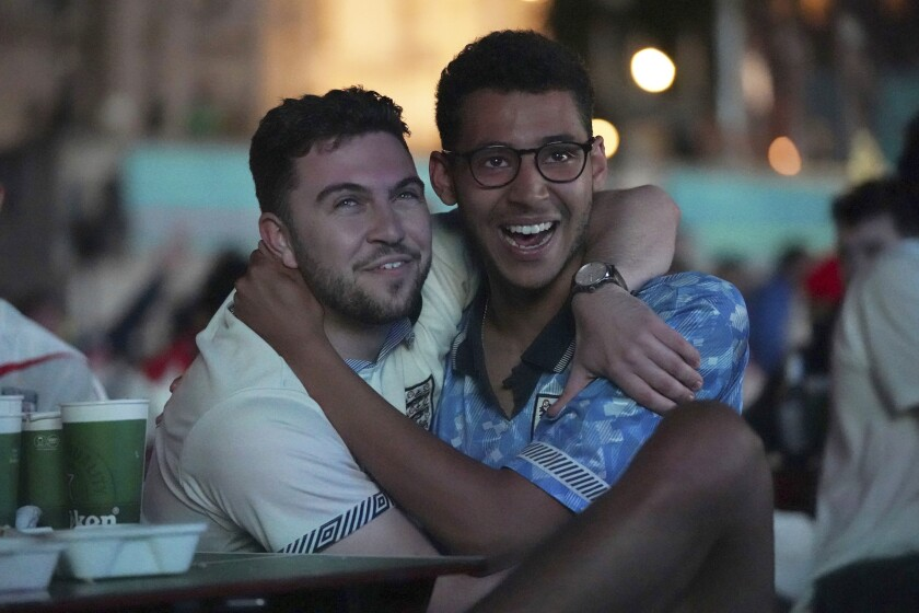 Fans in Trafalgar Square celebrate England qualifying for the Euro 2020 final as they watch remotely the Euro 2020 soccer championship semifinal match between England and Denmark, in London, England, Wednesday, July 7, 2021. (Kirsty O'Connor/PA via AP)