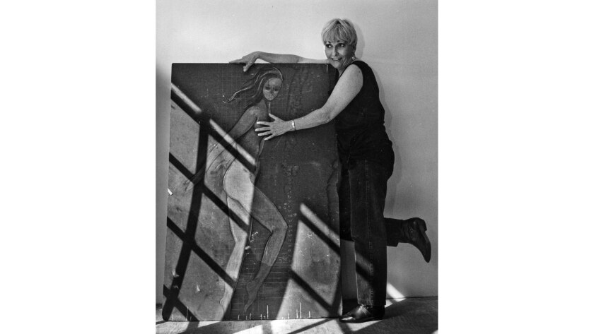 Oct. 10, 1991: Lynn Westmore Seemayer poses with a sketch she used as model for Pink Lady, a 1966 pa