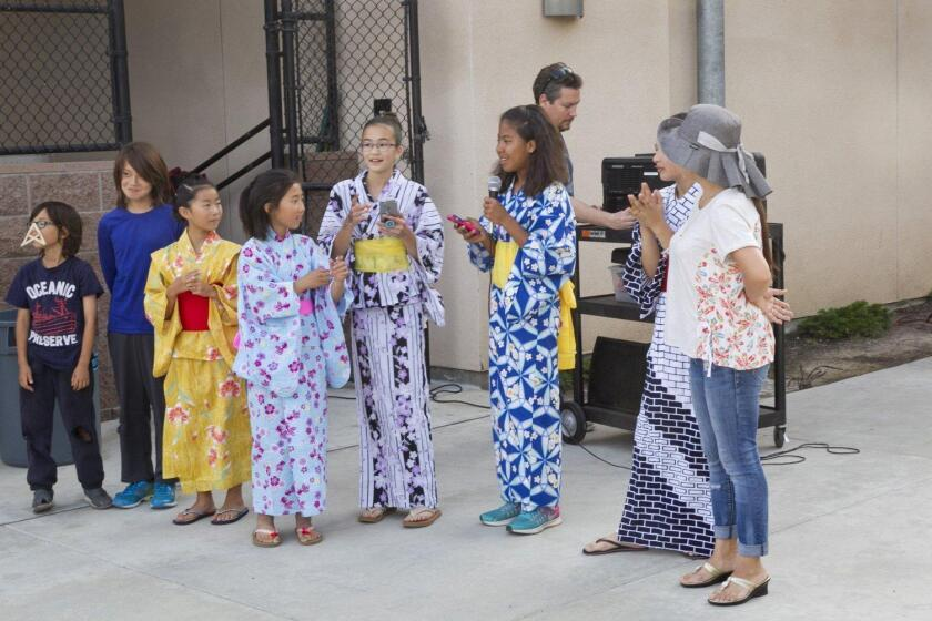 Solana Pacific students explain how to play a Japanese game
