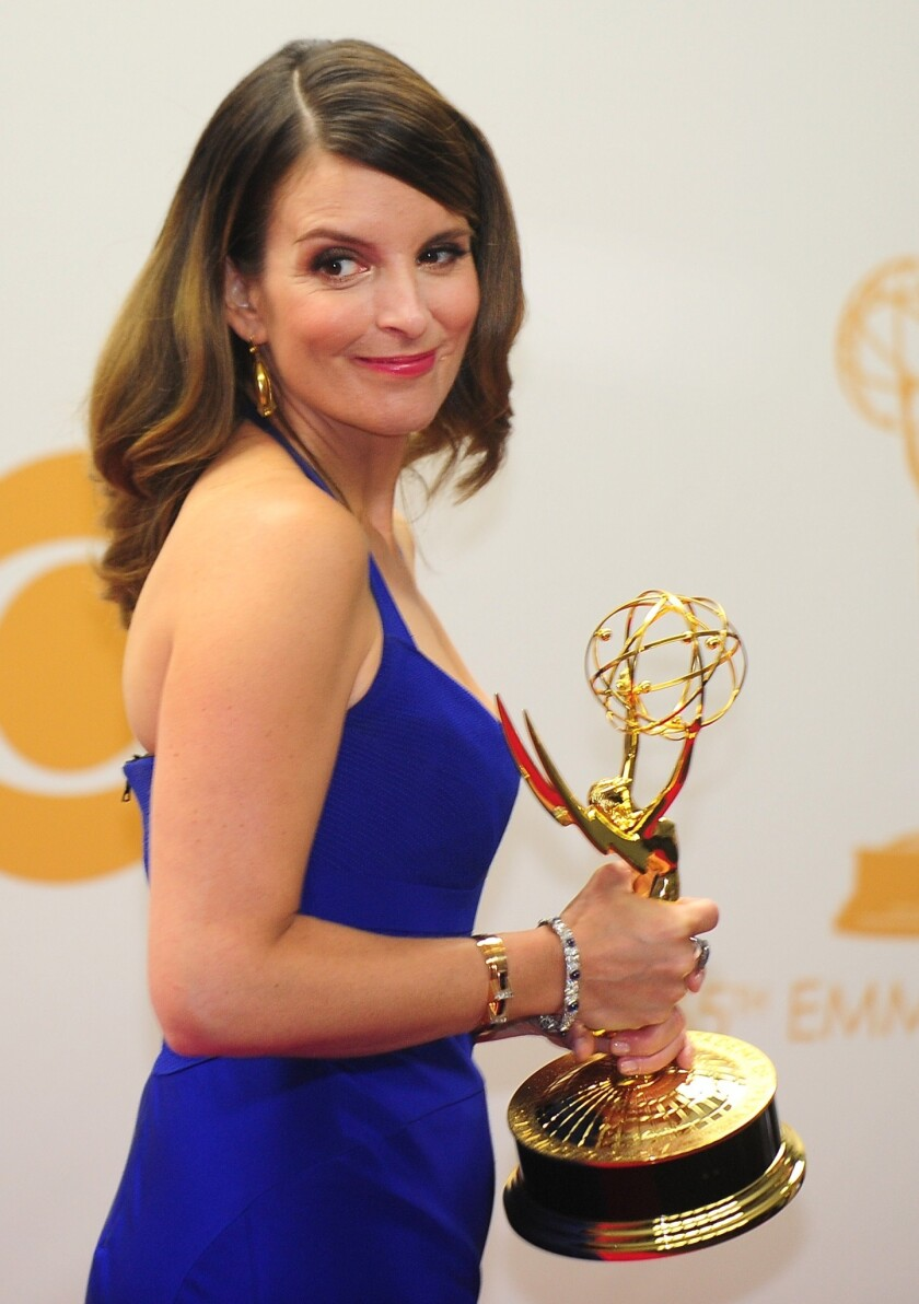 """Tina Fey with her Emmy for comedy writing for """"30 Rock."""""""