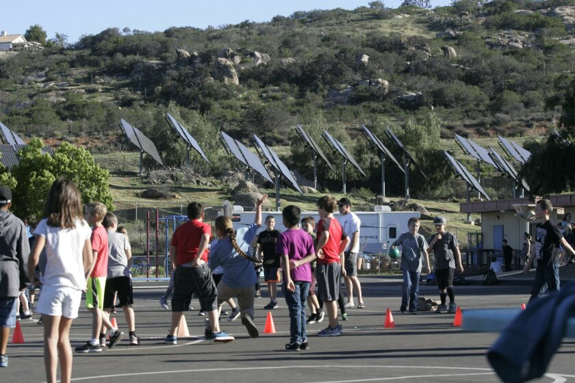 The solar panel field at Alpine elementary School was put in with the hopes of larger savings than they are realizing under a new rate structure.