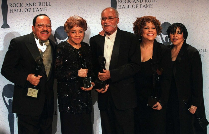 FILE - In tis March 15, 1999 file photo, The Staple Singers, from left, Pervis, Cleotha, Pops, Mavis, and Yvonne pose at the Rock and Roll Hall of Fame induction ceremony in New York. Pervis Staples, whose tenor voice complimented his father's and sisters' in The Staple Singers, died Thursday, May 6, 2021, at his home in Dalton, Ill., a spokesman for sister Mavis Staples, said Wednesday, May 12 , 2021. He was 85. (AP Photo/Albert Ferreira, File)