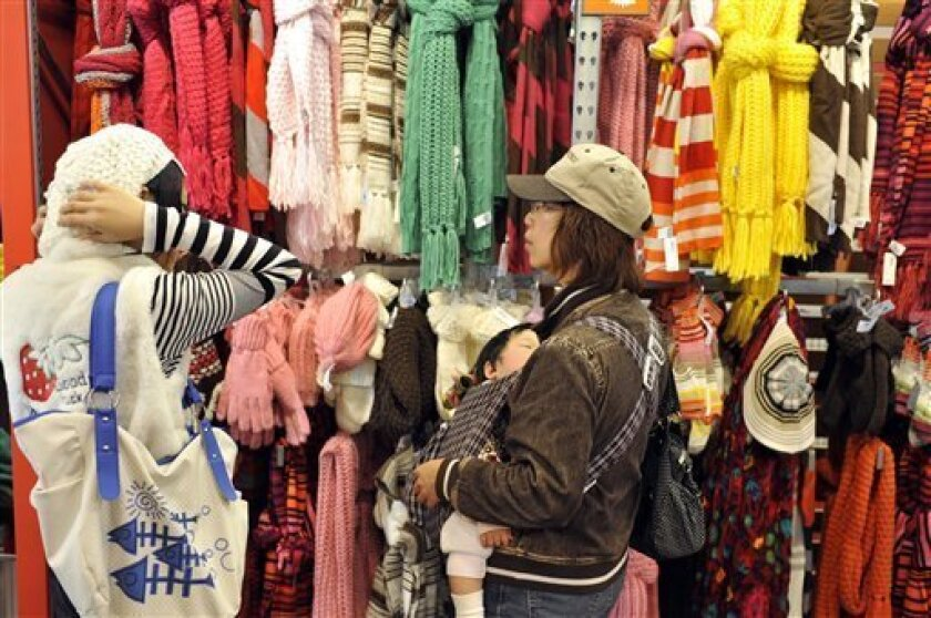 In this photo made Thursday, Nov. 26, 2009, customers shop during Old Navy's Thanksgiving sale in San Francisco. Retail sales rose more than expected in November, boosting hopes that the all-important consumer sector will support the fragile recovery.(AP Photo/Russel A. Daniels)