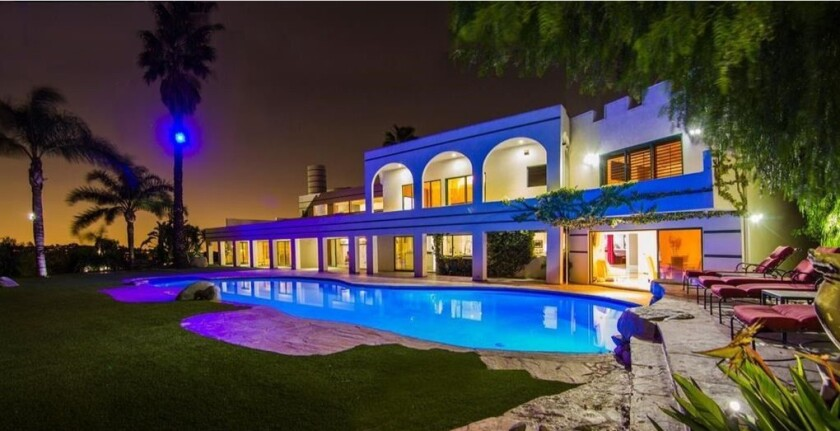 The flashy mansion spans 12,000 square feet with eight bedrooms and five bathrooms.
