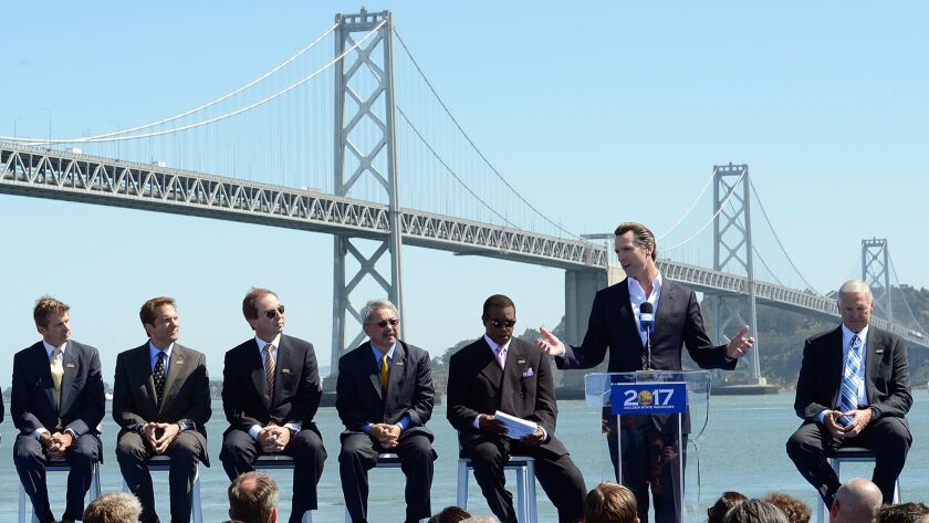 Lt. Gov. Gavin Newsom speaks at a San Francisco news conference with the Golden State Warriors to announce plans to build a new waterfront arena. From left are Rick Welts, Peter Guber, Joe Lacob, Mayor Edwin M. Lee, Ahmad Rashad and Jerry West.