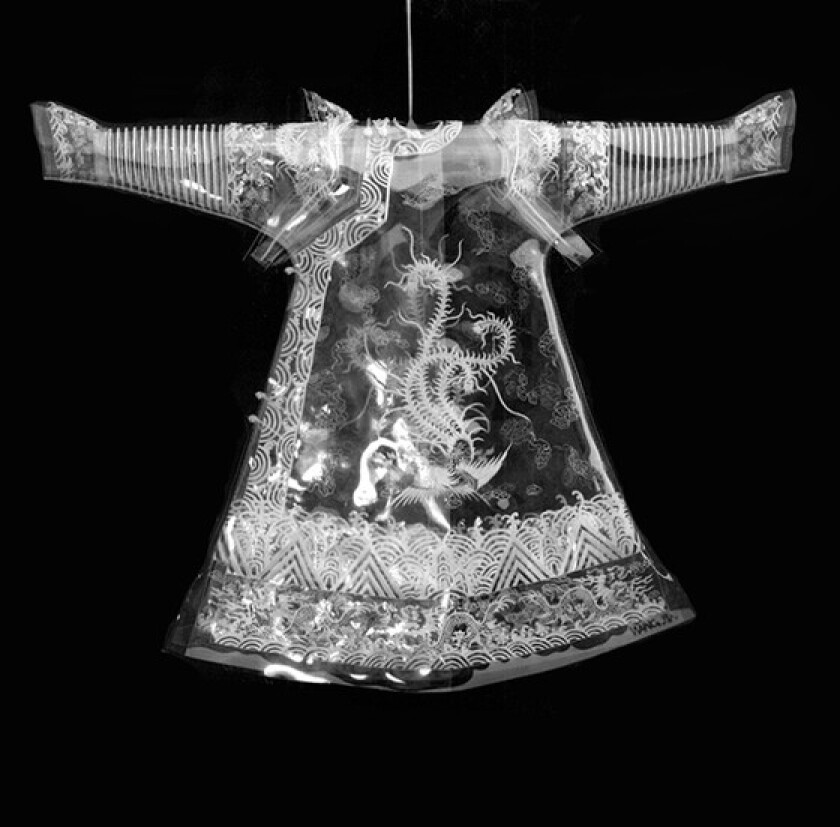 """""""Chinese Dream"""" by Wang Jin, 2006. Polyvinyl chloride with vinyl filament, iron chain, hook, 82.5 inches by 67 inches by 5 inches"""