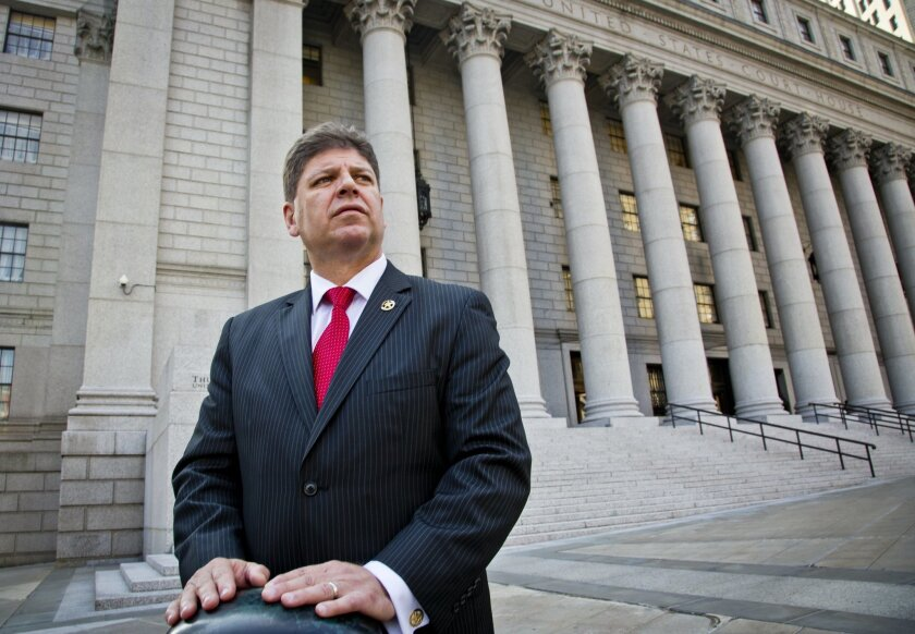 U.S. Marshall Director Michael Greco pose outside near courts the agency is responsible for, Thursday, Oct. 8, 2015, in New York.  Greco was recently named the first Hispanic U.S. marshal in the judicial district that includes Manhattan.(AP Photo/Bebeto Matthews)
