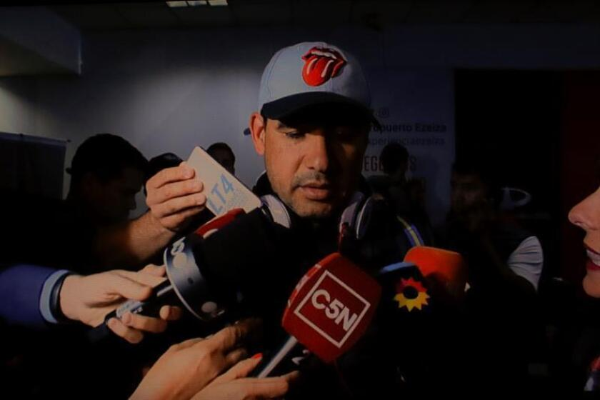 An image provided by Telefe Noticias that shows Maxi Mazzaro, a one-time leader of Argentine soccer club Boca Juniors' barra brava (gang of radical supporters), talking to reporters at Buenos Aires' airport on Dec. 7, 2018, after being deported from Spain. EPA-EFE/Courtsey Telefe Noticias/