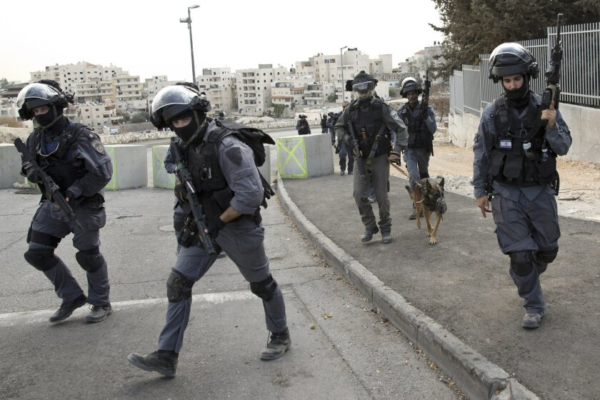 Israeli riot police officers operate in the Arab neighborhood of Issawiyeh in Jerusalem, Tuesday, Oct. 20, 2015.