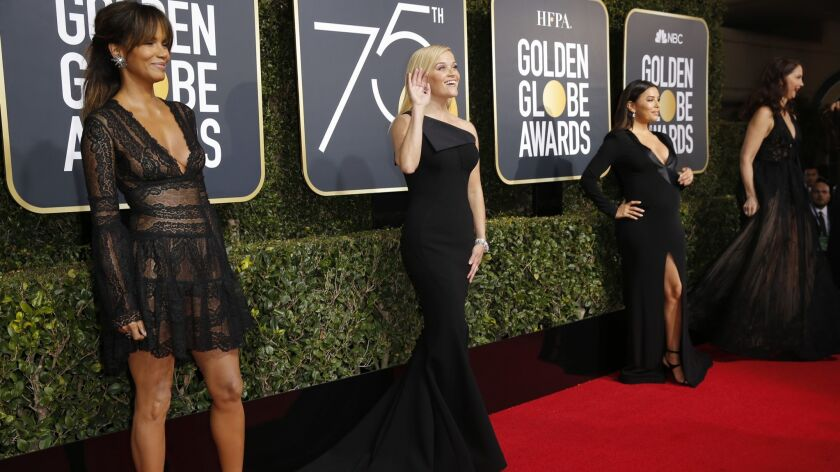 Halle Berry, left, Reese Witherspoon and Eva Longoria arriving at the Golden Globes in Beverly Hills in 2018, when Time's Up and #MeToo drove the red carpet conversations. Will this year be different?